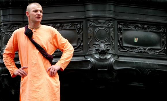 A Hare Krishna devotee watches the Ratha Yatra Chariot Carnival