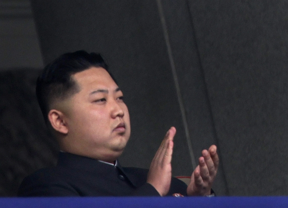 Kim Jong-un, the youngest son of North Korean leader Kim Jong-il, applauds during a military parade in Pyongyang