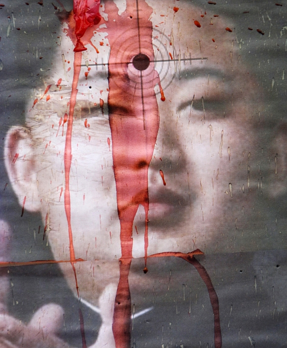 A portrait of Kim Jong-Un is seen during an anti-North Korea rally in Seoul