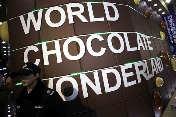 A security guard stands guard at a new chocolate theme-park in Shanghai