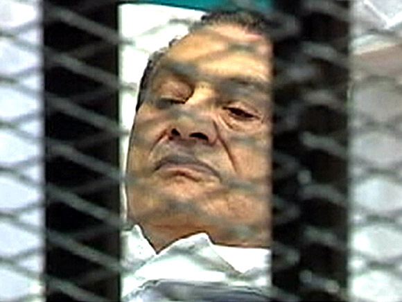 Former Egyptian president Hosni Mubarak is seen in the courtroom for his trial in Cairo