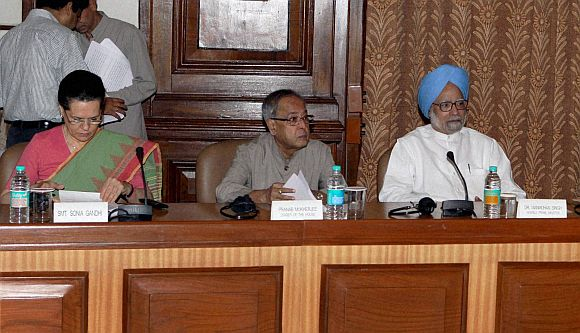 Sonia Gandhi with PM Singh and Finance Minister Pranab Mukherjee