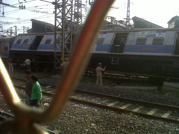 The derailed train compartment near Masjid station, Mumbai