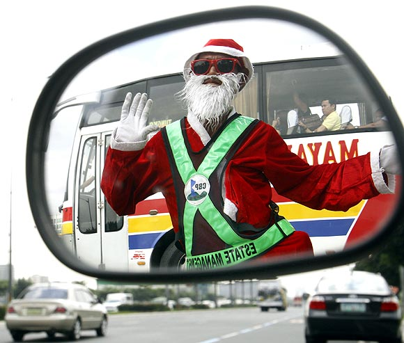 PHOTOS: Fun, flirty and frolicking SANTA CLAUS