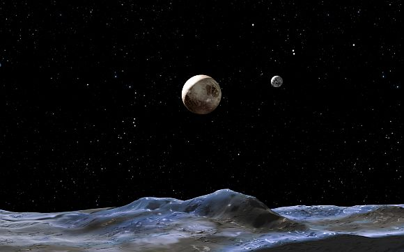 The artist's concept above shows the Pluto system from the surface of one of its moons