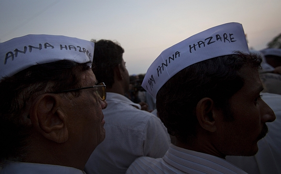 Demonstrators wearing caps similar to the one worn by social activist Anna Hazare gather during protest rally against corruption in Mumbai