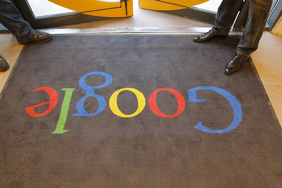 A Google carpet is seen at the entrance of the new headquarters of Google France