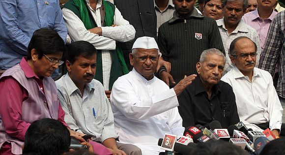 Anna Hazare addresses the media along with members of his team