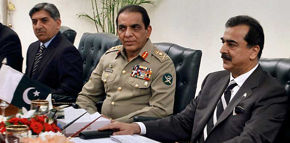 (Left to Right) ISI chief Shuja Pasha, army chief Ashfaq Kayani and Pakistan Prime Minister Yousuf Raza Gilani