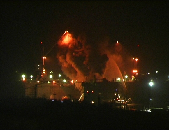 Firefighters work to extinguish fire at the Roslyakovo shipyard in the northern Russian region of Murmansk, in this still image taken from video