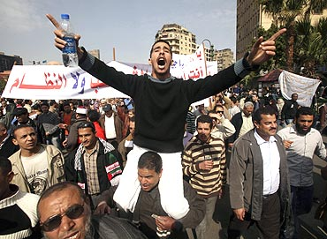 A protester gestures during an anti-Mubarak protest in Cairo onm Tuesday