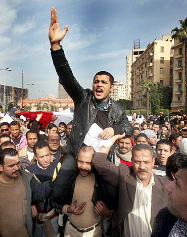 A protester gestures during an anti-Mubarak protest in Cairo on Tuesday