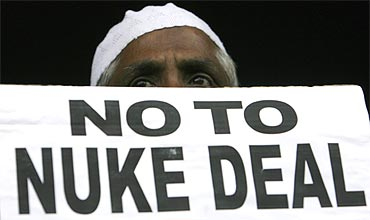 An activist holds a placard to protest against the nuclear deal