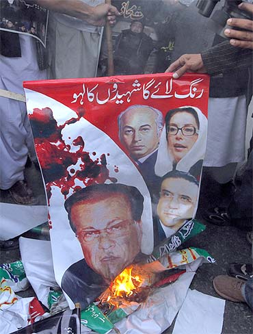 Protesters burn an image of slain Punjab Governor Salam Taseer in Lahore in support of his killer