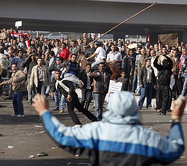 Pro and anti-Mubarak supporters clash during rioting at Tahrir Square