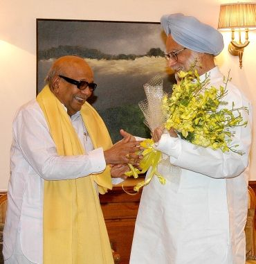 A file photo of Prime Minister Manmohan Singh with DMK supremo Karunanidhi in happier times