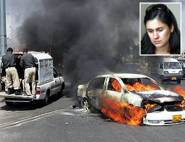 Angry protestors set a car on fire in Karachi (Inset) Kamila Shamsie