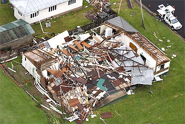 A house lies in ruins after Cyclone Yasi passed the northern Australian town of Tully