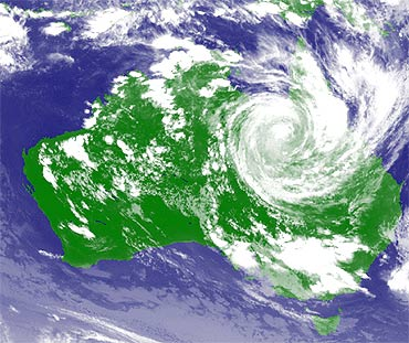 A weather satellite image, courtesy of the Japan Meteorological Agency, shows Cyclone Yasi moving inland through the state of Queensland, Australia.