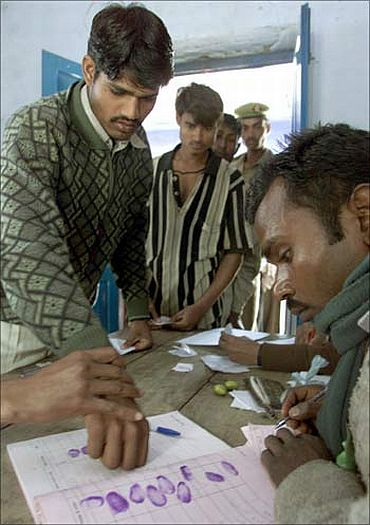 An Indian voter registers his vote using his fingerprint