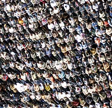 Anti-government protesters take part in Friday prayers at Tahrir Square in Cairo