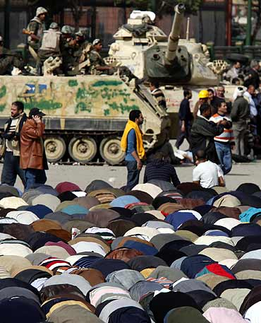 Opposition supporters take part in Friday prayers in Tahrir Square in Cairo