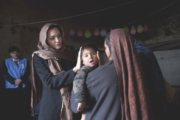Angelina Jolie meets Khanum Gul, a mother of eight and her youngest son, Samir at their makeshift home at Tamil Mill Bus site in Kabul