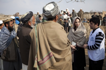 Jolie is greeted by village elders upon arrival in Qala Gudar village in Qarabagh District