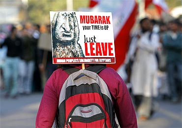 A student activist attends a protest against President Mubarak outside the Egyptian embassy in New Delhi
