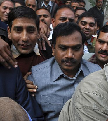 Former telecommunications minister A Raja leaves CBI headquarters in New Delhi as he was arrested for his alleged role in the 2G Spectrum scam