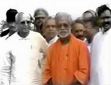 Swami Assemanand (Centre, in orange robe)