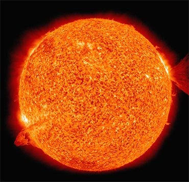 This image of the sun, captured by The Solar Dynamics Observatory spacecraft, shows nearly simultaneous solar eruptions on opposite sides of the Sun
