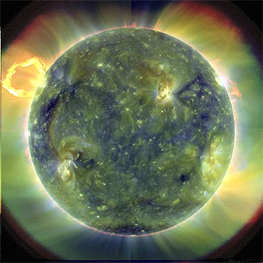 An extreme ultraviolet image, using false colours to trace different gas temperatures, of the sun taken by the Solar Dynamics Observatory