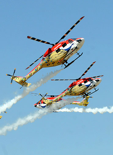 Sarang team perform during Aero India 2011 at Yelahanka Airforce station in Bangalore