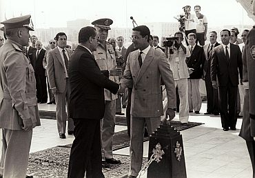 Mubarak (left), shaking hands with Gamal Sadat, the son of the late Anwar Sadat, during celebrations marking the 12th anniversary of October 1973 war with Israel, in Cairo on October 6, 1985