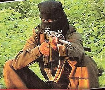 A Maoist trains his gun, somewhere in Central India