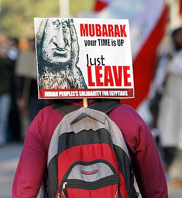 An activist from the All India Students Association (AISA) attends a protest against Egypt's President Hosni Mubarak outside the Egyptian embassy in New Delhi