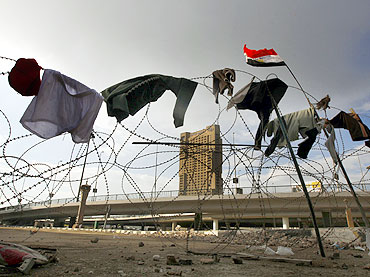 Anti-government protesters' clothes on the barbed wire at the front line of their stronghold in Tahrir square in Cairo