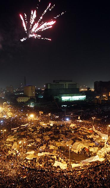 Thousands of Egyptian anti-government protesters celebrate inside Tahrir Square after the announcement of Egyptian President Hosni Mubarak's resignation in Cairo