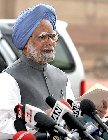 India's Prime Minister Manmohan Singh addresses the media