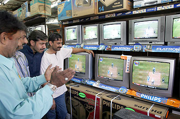 Pakistani fans watch a one-day match against India in Karachi.