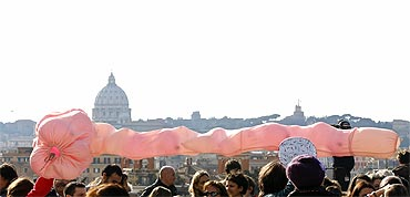 Women hold a balloon during a demonstration against Berlusconi in downtown Rome