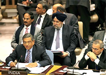 Foreign Minister S M Krishna read the wrong speech at the UN on Friday before being corrected by Ambassador Hardeep Puri, seen standing behind.