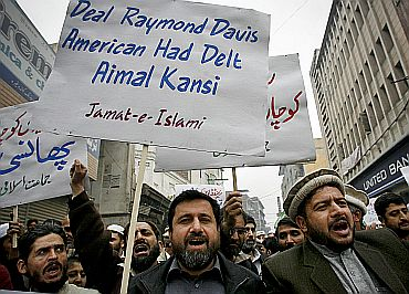 Supporters of the Jamaat-e-Islami take part in a protest rally against Raymond Davis in Peshawar