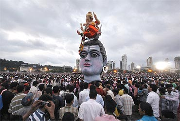 Devotees gather during the immersion of idols of Lord Ganesh in Mumbai
