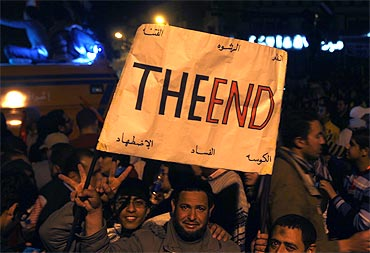 Protesters celebrate the end of Mubarak's regime in Tahrir Square
