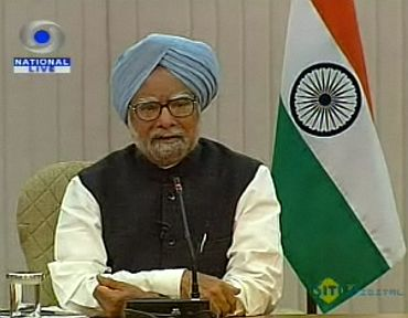 Video grab shows Prime Minister Manmohan Singh interacting with TV Editors at his residence