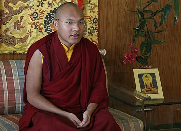 Karmapa Lama speaks during an interview in Dharamsala