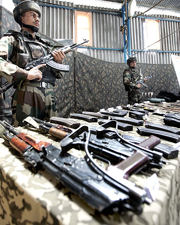 Arms and ammunition seized from LeT militants displayed at Kupwara in Kashmir