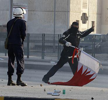A policeman confronts a protester